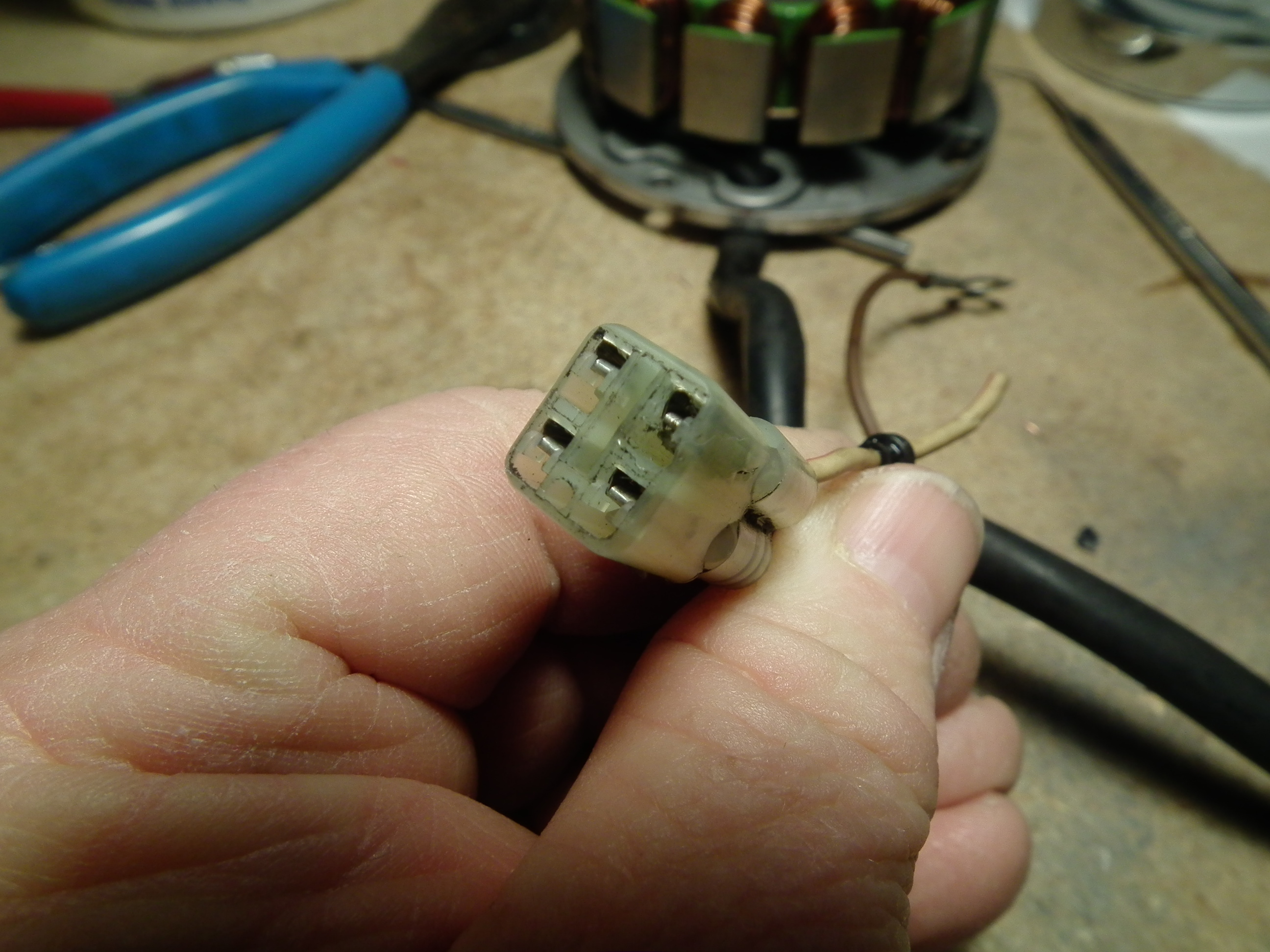 removing terminal pins from stator connector