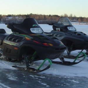 The twins sitting on the pond - Here is a snap of the twin 800's. Still no ridable snow on the trails so.. guess its a ponds and lakes only season.