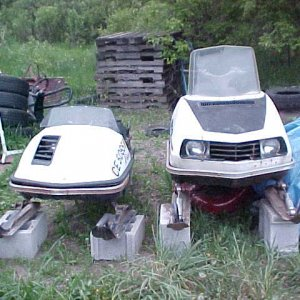 1974 Polaris TC 175, 1974 Polaris Custom II 400 - these are very old and are no longer outside.  the Custom II has no cracks in the seat, only one sma
